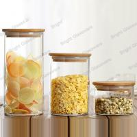 Buy cheap High quality round cylinder glass candy jar crystal glass jar with wood lid product