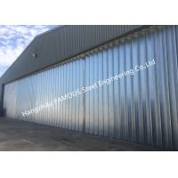 Buy cheap Stable Triangular Seal Vertical Hinged Door Sectional Leaves Folding Sliding Hangar Doors product