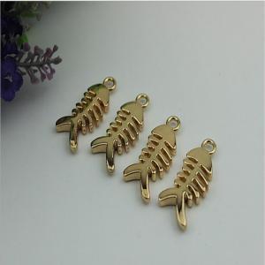 Buy cheap Small light gold fish bones pattern zinc alloy metal handbag logo label tags for sales product