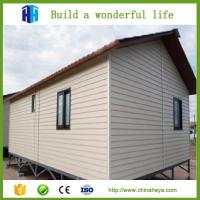 Low cost steel frame prefab movable sandwich panel house for Panel homes prices