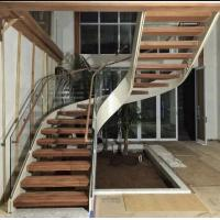 Buy cheap Indoor use wood step glass railing steel curved staircase from wholesalers