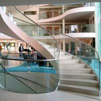 Buy cheap Wood Step Glass Rails Curved Staircase with Stainless Steel Stringer and Glass Railing product