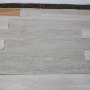 Buy cheap non deformation wood grain uv coating embossed PVC vinyl flooring planks product