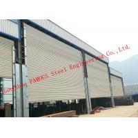 China Frequency Controlled Vertical Lifting Fabric Industrial Doors For Large Openings on sale