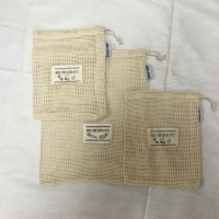 Reusable organic cotton mesh produce bag with drawstring and label tag for grocery shopping fruit vegetable bag