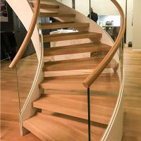 Buy cheap New Style Curved Staircase Solid Wood Treads and Tempered Glass Railings product