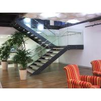 Material: stair frame: Lacquered carbon steel; Glass stair railing; wooden stair treads; SS Handrail