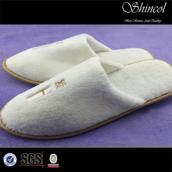 Quality white velour slippers for hotel use for sale