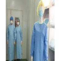 Surgical gown with knitted cuff